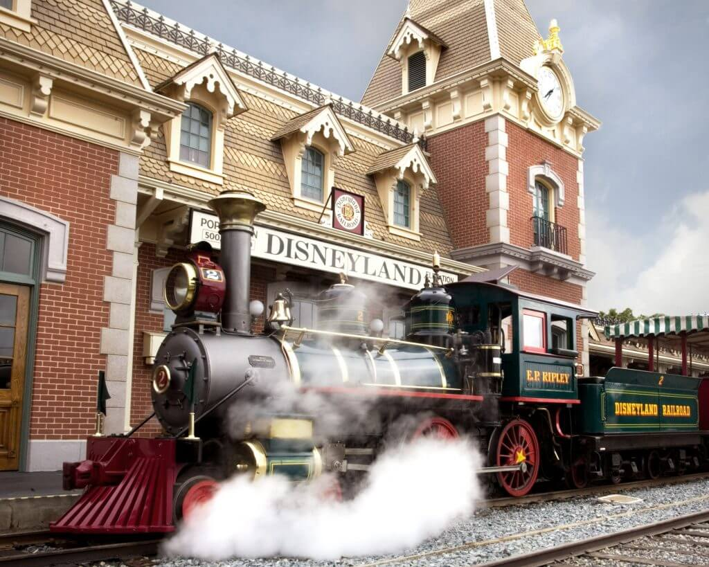Photo of the Disneyland Railroad, With its turn-of-the-century architecture and lush gardens, the Main Street station offers the first point of entry for those who wish to soak up the scenery on a grand circuit tour of Disneyland park aboard one of the trains of the Disneyland #disney #disneyland #disneylandrailroad