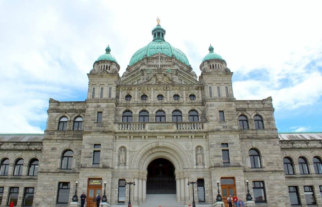 Victoria with Kids: 13 Kids Activities to Do when Visiting Victoria Canada featured by top family travel blogger, Marcie in Mommyland: Photo of the Parliament Building as part of our Greyline Victoria Hop On Hop Off bus tour around downtown Victoria, BC.