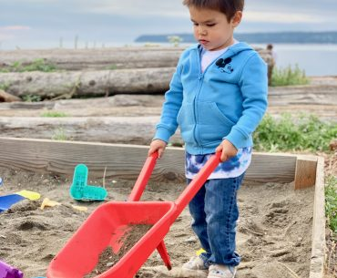 Semiahmoo Resort & Spa is a kid-friendly resort in Washington State with activities like this big sandbox filled with toys. | Semiahmoo Resort and Spa review featured by top US travel blogger, Marcie in Mommyland