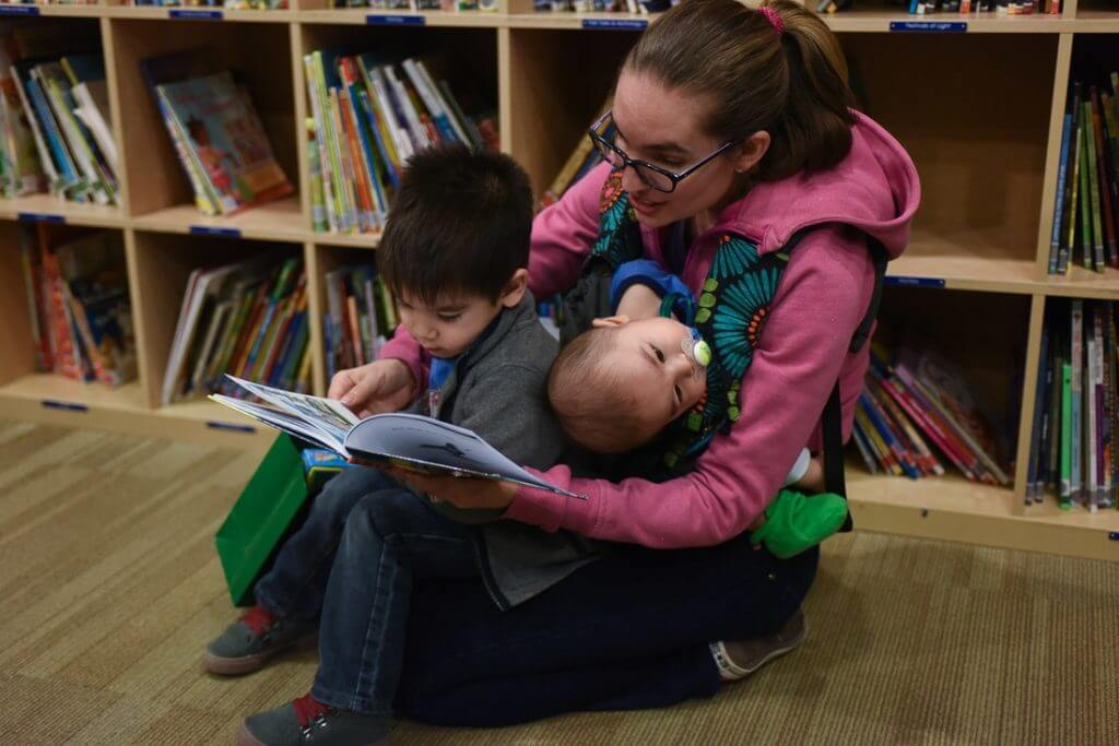My son wanted me to read another story during Story Time. Photo credit: Darren Cheung