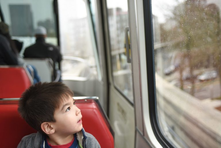 My 3yo looked in awe on his first ride on the Seattle Monorail. Photo credit: Darren Cheung -