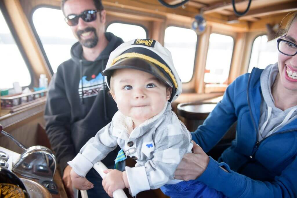 Photo of our honorary sea captain on the San Juan Island Excursion Whale Watching Boat Trip, which is our favorite San Juan Island whale watching tour. #sanjuanisland #pnw #washingtonstate #sanjuanislands #whalewatching #whalewatchingtour #whalewatchingcruise #pnw