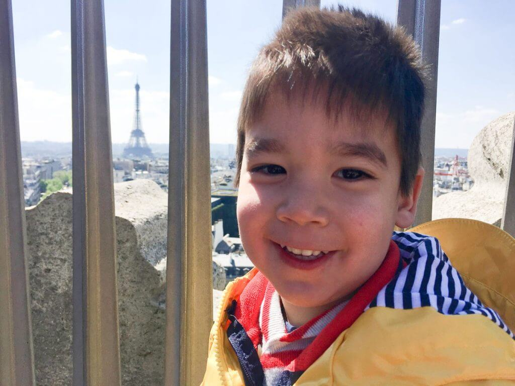 Photo of the Eiffel Tower from the top of the Arc de Triomphe on a Paris family vacation with kids #eiffeltower #arcdetriomphe #pariswithkids #familytravel