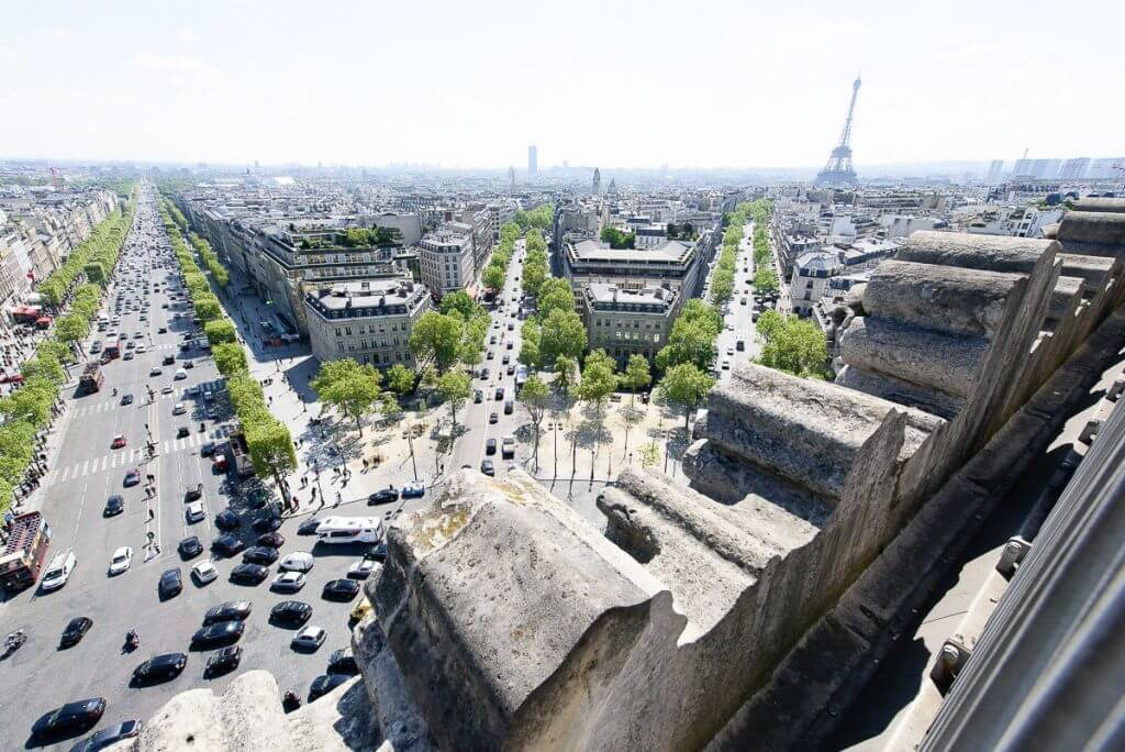 Photo of the Arc de Triomphe Terrace, overlooking the Eiffel Tower and Champs Elysées in Paris, France #eiffeltower #champselysees #arcdetriomphe #paristour #pariswithkids