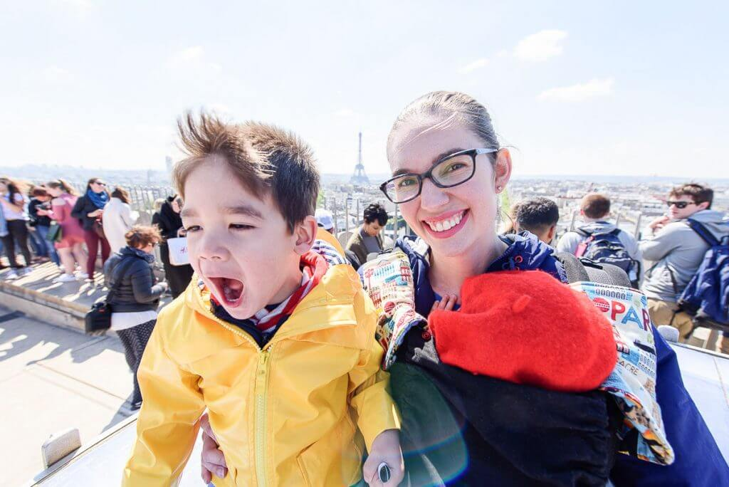 Photo of kis on the Terrace of Arc de Triomphe in Paris, France, which is a kid-friendly attraction in Paris #eiffeltower #arcdetriomphe #pariswithkids #familytravel