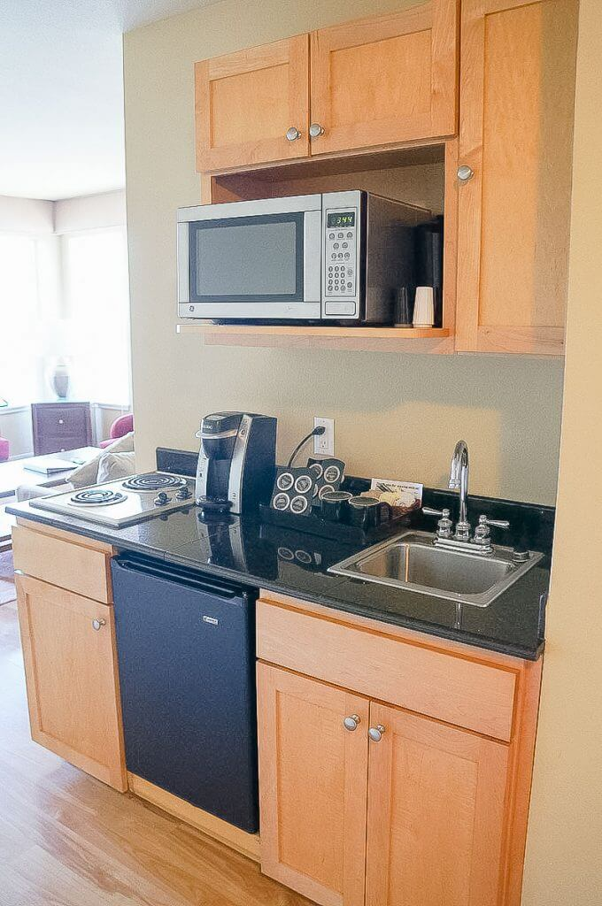 Photo of the kitchenette at the Cannery Pier Hotel, a top Astoria Oregon hotel #astoriahotel #astoriaaccommodation #travelastoria #oregon