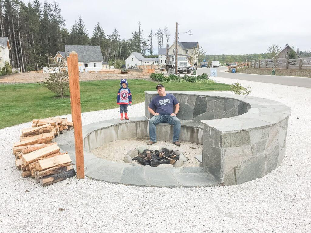 Photo of a large outdoor fire pit where families can roast marshmallows, which is one of the fun things to do in Seabrook, Washington with kids #firepit #seabrook #seabrookwa #pnw #washingtonstate #washingtoncoast