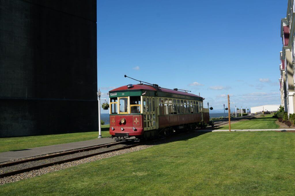 Photo of the Astoria Oregon Trolley, also known as the Astoria Riverfront Trolley as it runs along the Columbia River #astoriatrolley #astoriariverfronttrolley #astoriaoregon #visitoregon #exploreoregon #oregoncoast