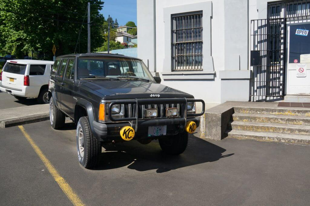Photo of the Oregon Film Museum, which is a stop on any Astoria, Oregon Goonies Tour, since that's the Goonies Jeep and jailhouse from The Goonies! #thegoonies #astoriaoregon #visitastoria #oregonfilmmuseum
