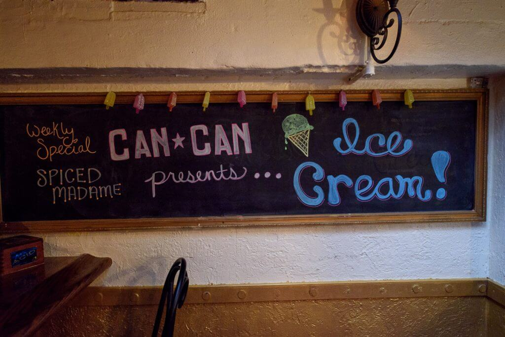 It was too dark to take photos of the food, so here's a cute sign from the bar. Photo credit: Darren Cheung
