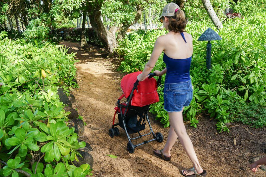We took the travel stroller off-road to the beach on Kauai. Photo credit: Julie Wirtz