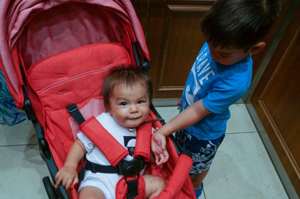 My oldest loved to play with his brother in the stroller because he was at a good height. Photo credit: Darren Cheung