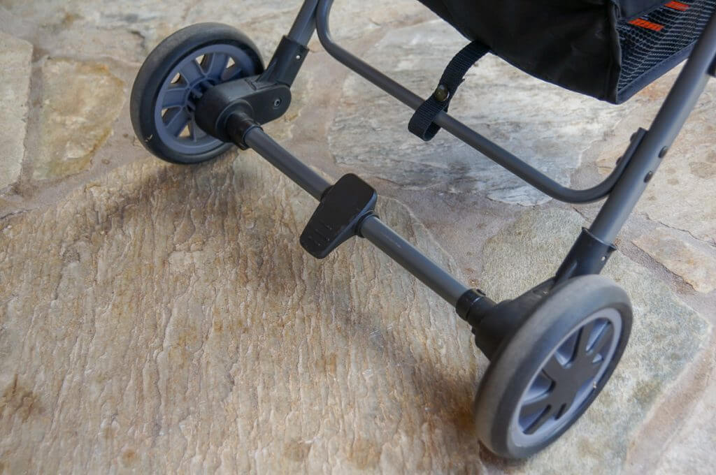 This flip flop friendly brake on this lightweight travel stroller is easy to use.