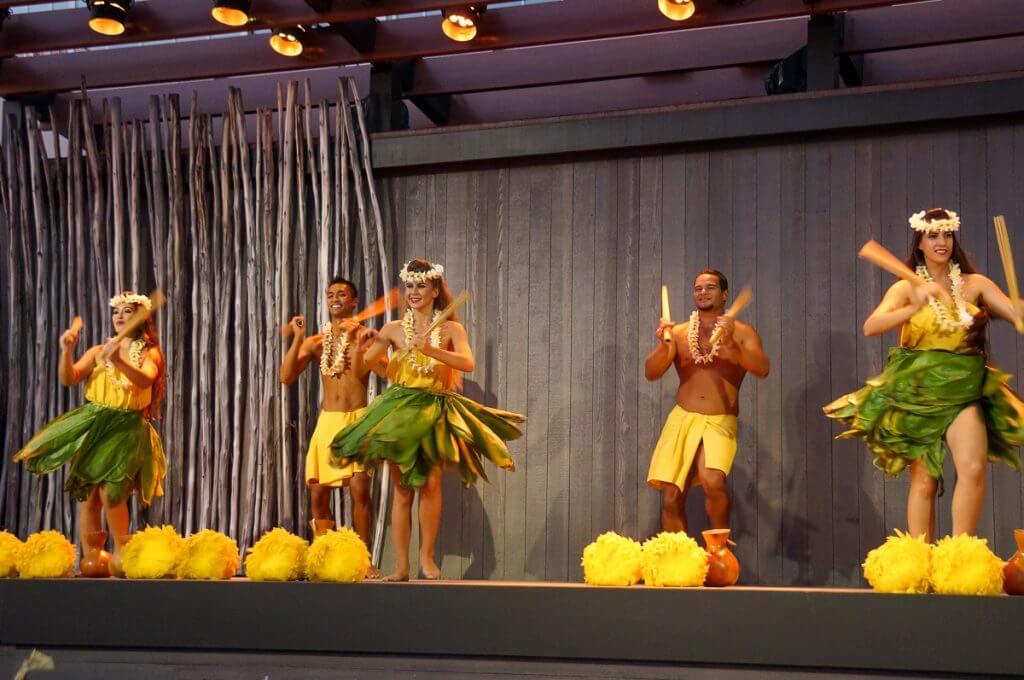 Hula auana, modern hula, with Hawaiian implements.
