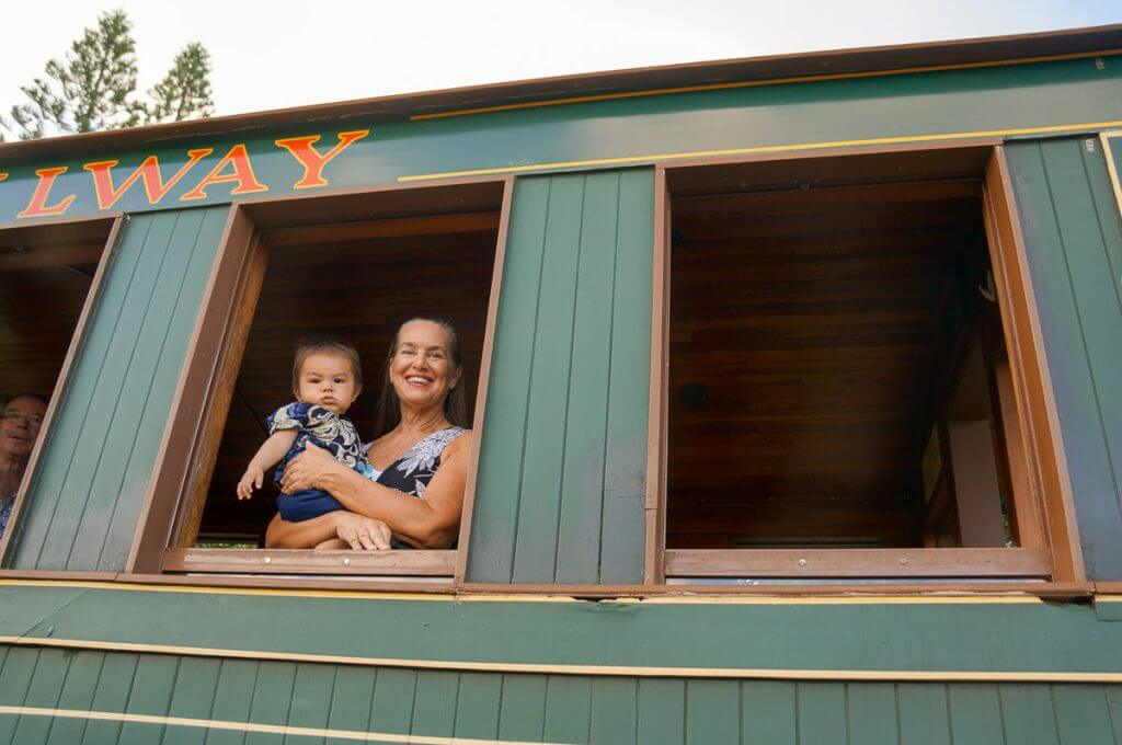 Photo of the Kauai train ride at Kilohana Plantation, which is a fun thing to do in Kauai with kids.