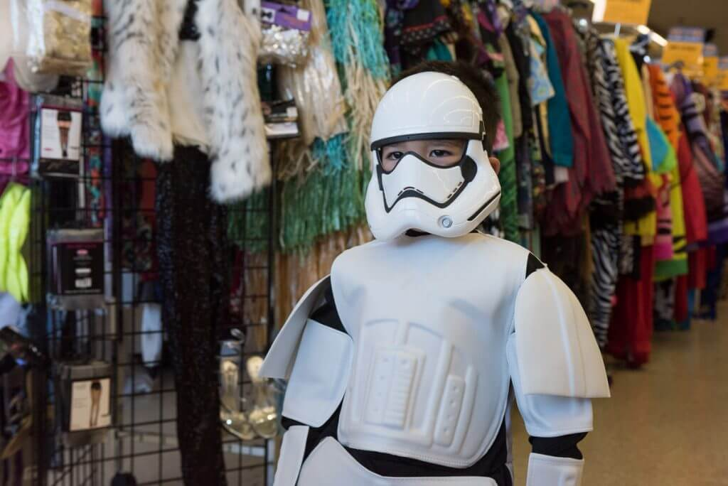 You'll definitely want to get your Halloween costumes at Goodwill this year. Image of a boy wearing an official Storm Trooper costume at Goodwill that was WAY cheaper than the Disney store!