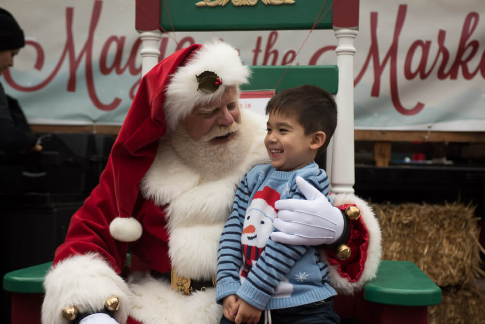visiting santa trever at magic in the market is one of our favorite christmas activities photo credit darren cheung snowman sweater courtesy of jojo - Christmas Activities In Seattle