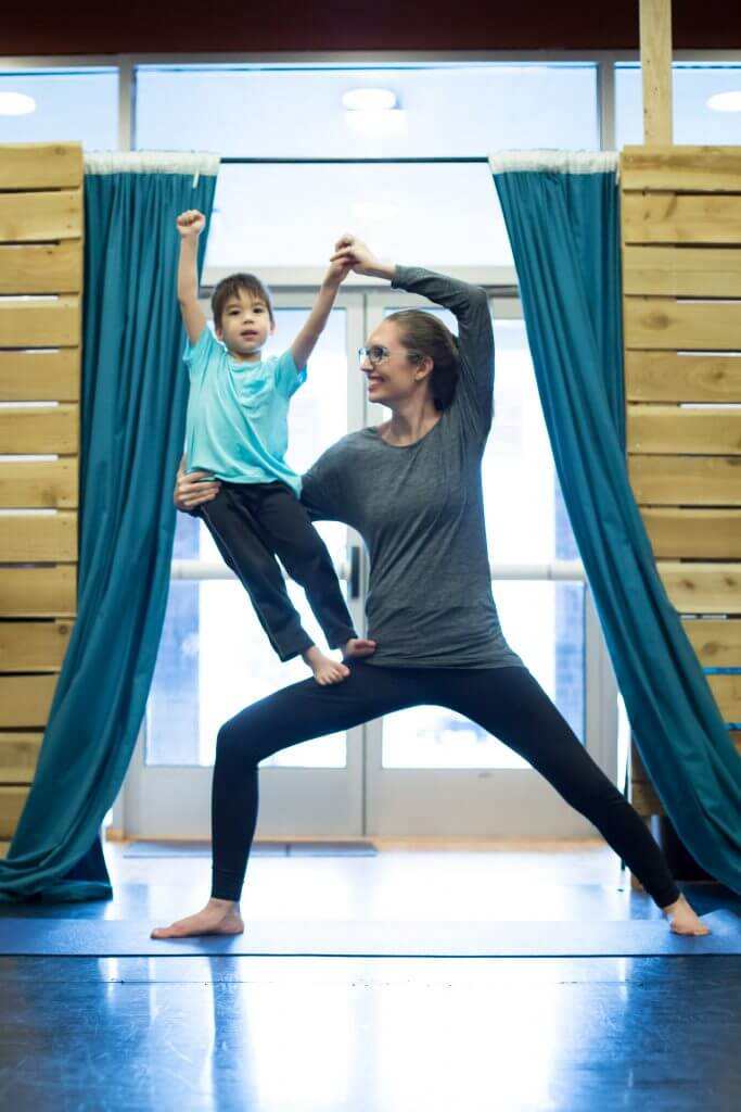 Partner yoga for kids is a great way to build trust and communication skills.