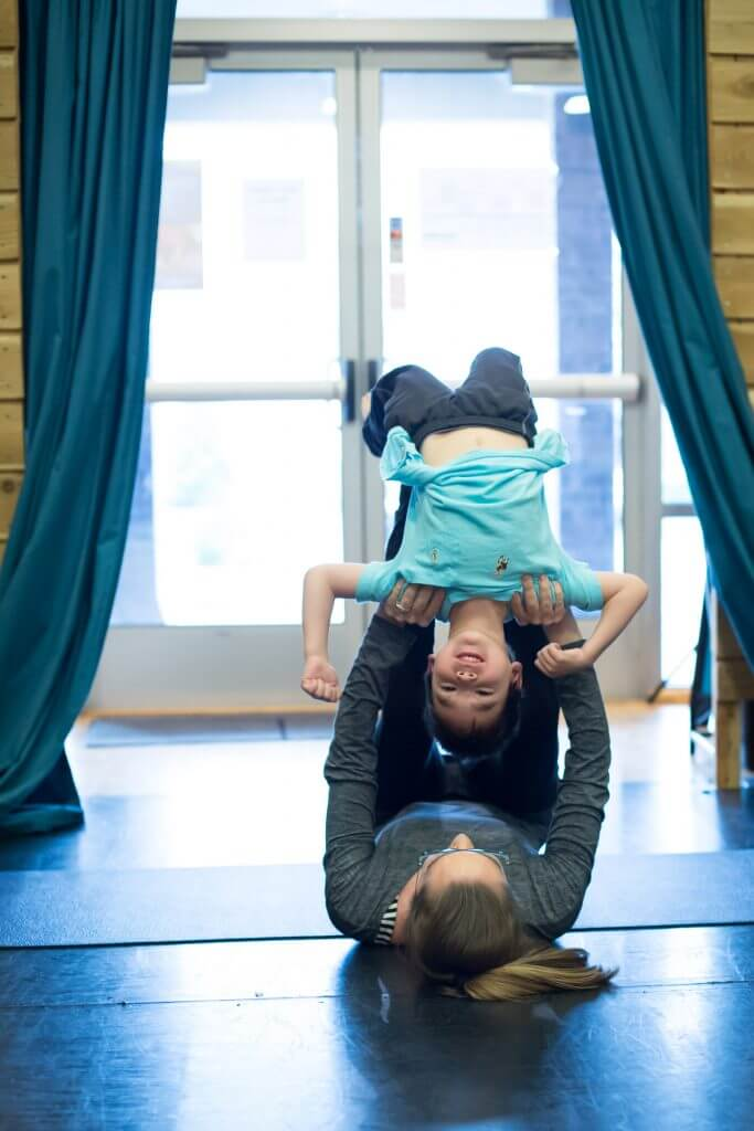 Safety is a priority when doing partner yoga with kids of any age.