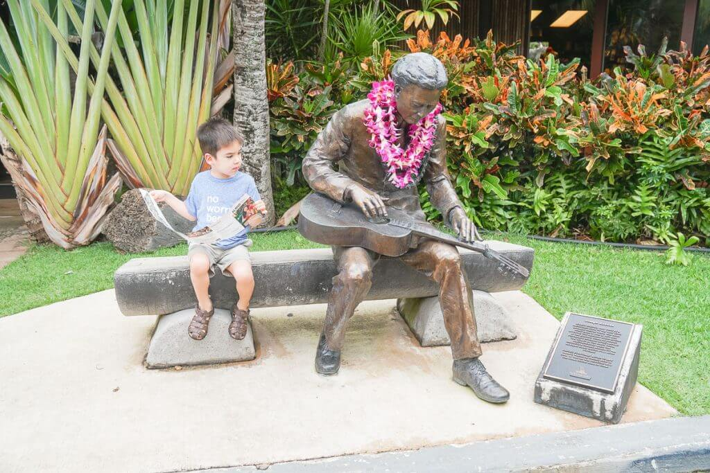 This photo op is just one of the things to do in oahu with kids at the Polynesian Cultural Center