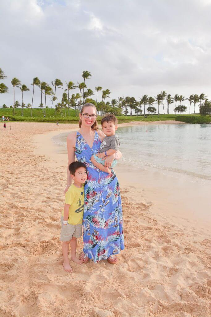 The Disney Aulani PhotoPass photographers will take sunset photos on the beach for family pictures.