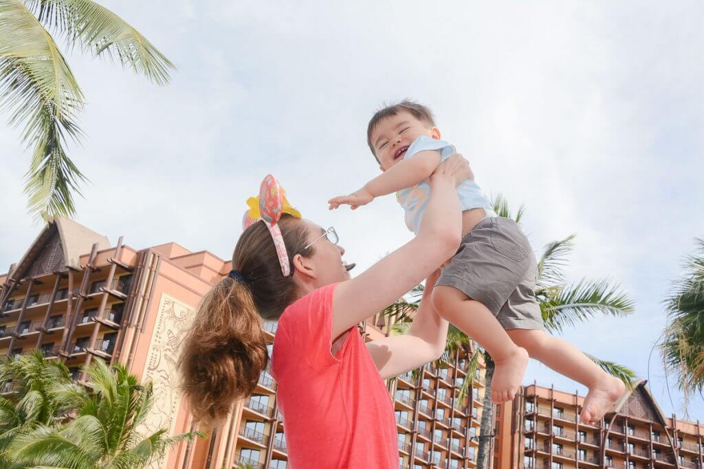 Disney Aulani PhotoPass photographers will take photos of your family on your Oahu family vacation.