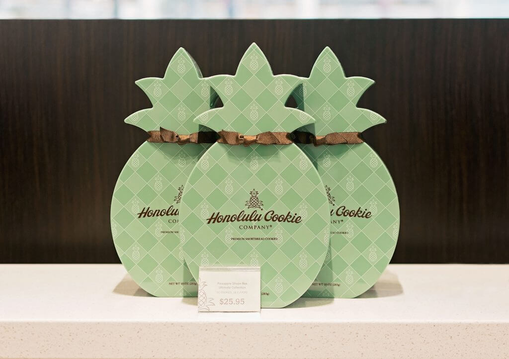 Photo of Honolulu Cookie Company pineapple shaped gift boxes of Hawaiian cookies.