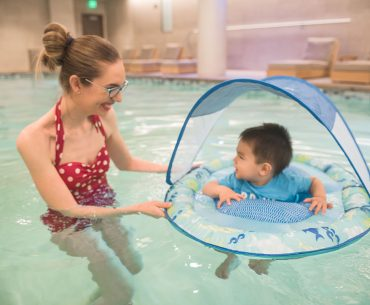 Photo of a mom and baby learning to swim in celebration of National Learn to Swim Day #SwimWays #BabySpringFloat #SpringFloat #NationalLearnToSwimDay #FloatwithSwimWays #IC