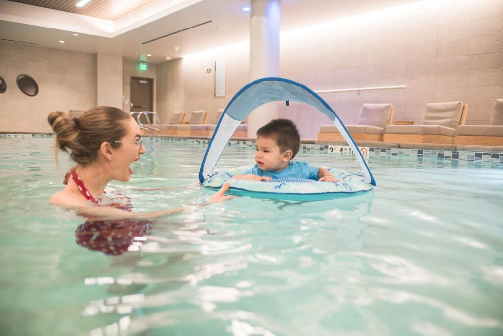Photo of a baby pool float at the Hyatt Regency Lake Washington for a Seattle staycation #swimways #poolfloat #poolinflatable #swimmingpool