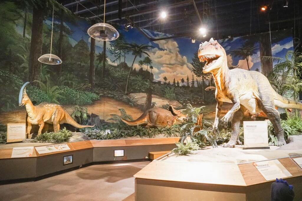 Photo of dinosaurs at Pacific Science Center in Seattle, which is a fun thing to do in Seattle with kids #dinosaurs #dinosaurexhibit #seattlecenter #pacsci #pacificsciencecenter