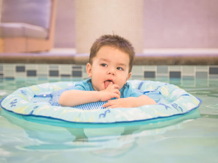 Photo of a toddler in a SwimWays pool float, which is a great summer pool safety tip for kids #swimways #pool #poolsafety #summer