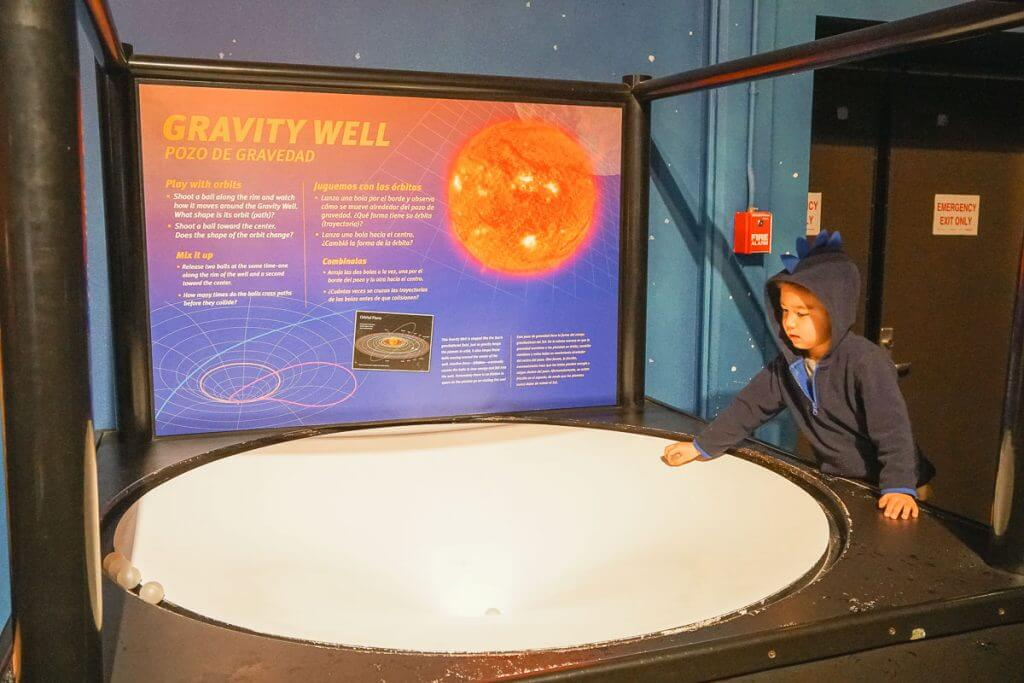 Photo of the Gravity Well at Pacific Science Center, which is a fun thing to do in Seattle with kids #pacificsciencecenter #pacsci #seattlecenter #STEM #seattle #seattlewa #familytravel