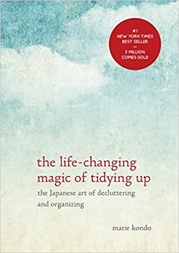 Photo of The Life-Changing Magic of Tidying Up by Marie Kondo featuring the KonMari method of folding and the KonMari method checklist #konmari #mariekondo #thelifechangingmagicoftidyingup #springcleaning #organization