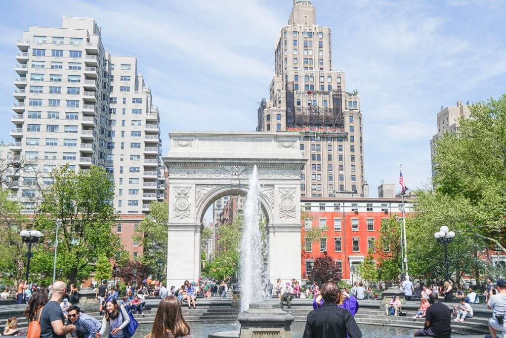 Photo of the Greenwich Village fountain and Washington Park Arch in New York City, which is a top instagrammable pot in NYC #greenwichvillage #washingtonparkarch#nyc #nycphoto