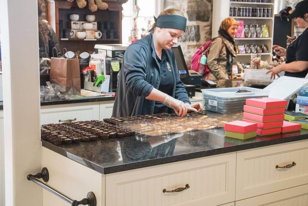 Photo of someone making chocolate at Chocolaterie de l'Ile d'Orleans, which is a fun thing to do in Quebec City #quebecregion #chocolate #quebecattractions #wits18