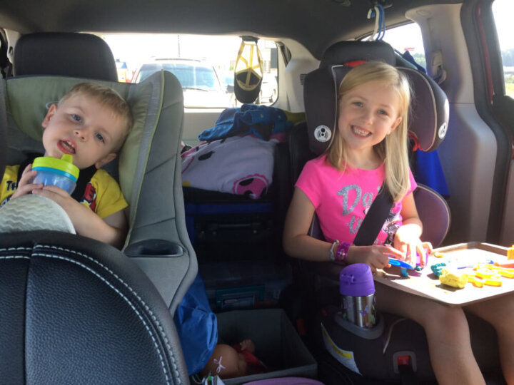 Photo of kids on a family road trip during summer travel #roadtrip #familytravel #traveltips #roadtriptips #nationalchildrenscancersociety
