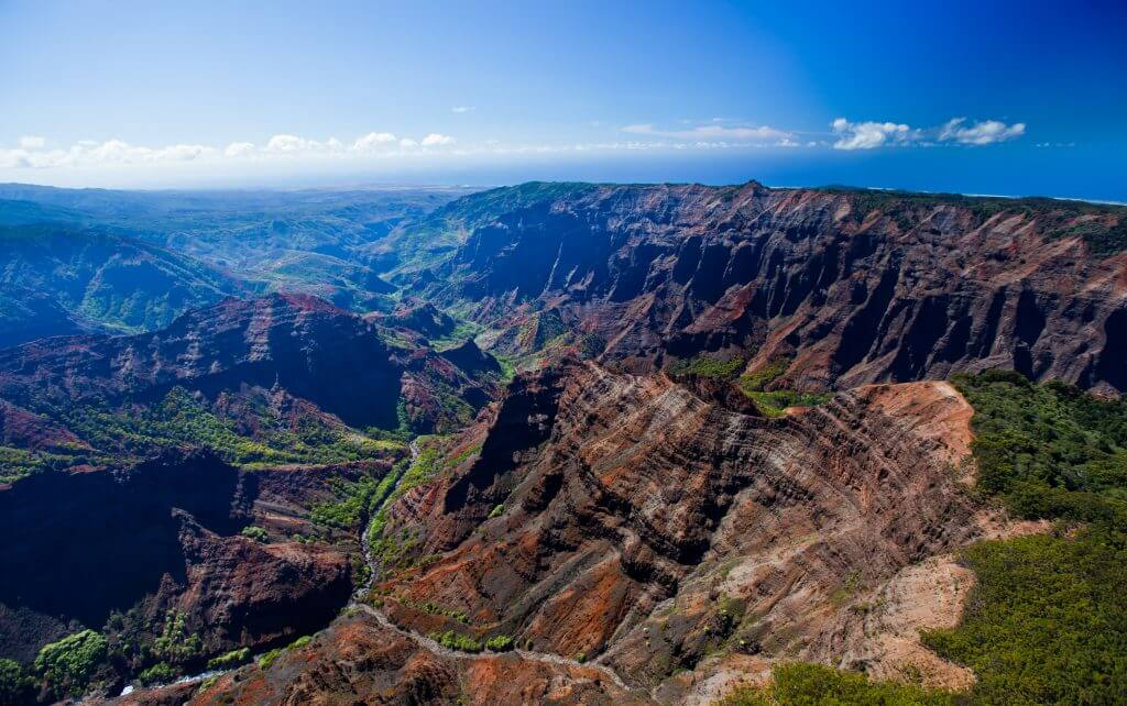 Photo of Waimea Canyon on Kauai, which is a top Kauai attraction and thing to do on Kauai #waimeacanyon #kauai #kauaiattraction #hawaii #hawaiiwithkids