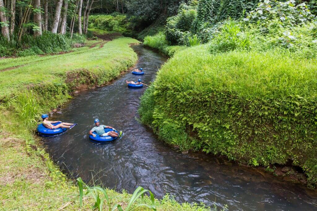 Photo of Kauai mountain tubing, a kid-friendly activity on Kauai for families looking for adventure #kauai #tubing #adventure #familytravel #hawaii #hawaiiwithkids #visitkauai