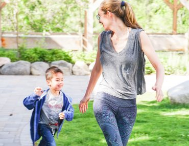 Photo of a mom and boy playing tag in a park in Withrop, Washington as a way to stay healthy during family travel #yogaclub #playing #kids #parenting #familytravel