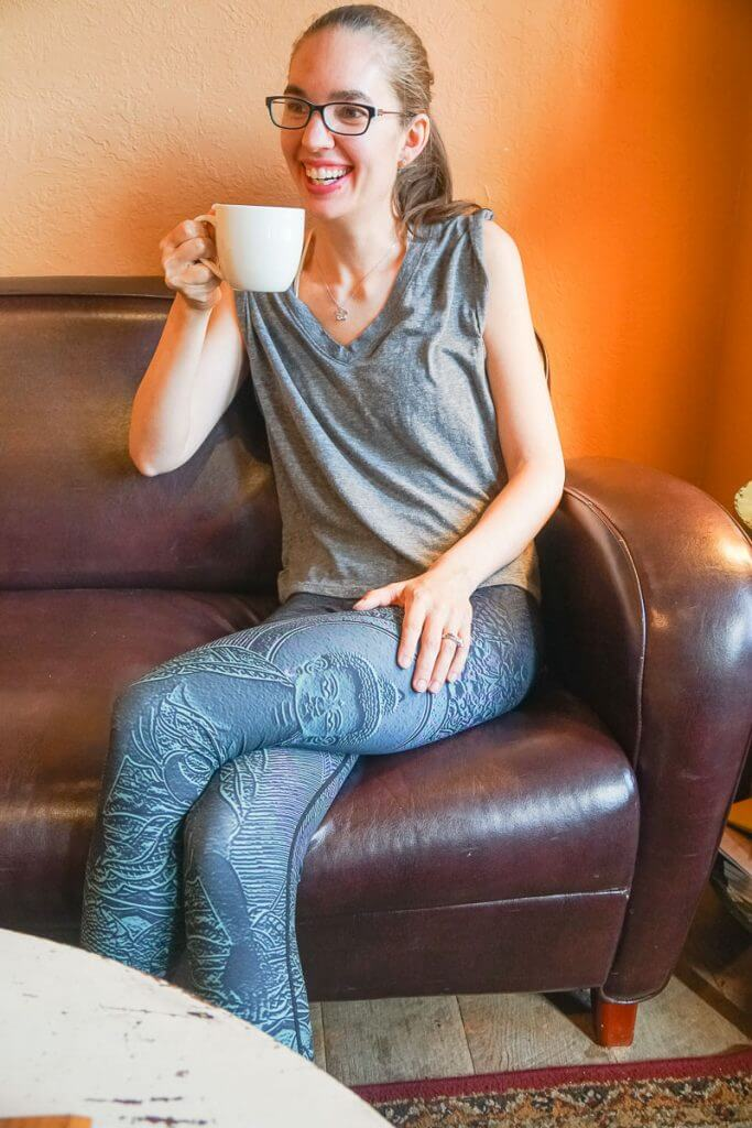 Photo of a mom drinking coffee in yoga wear from <a href=