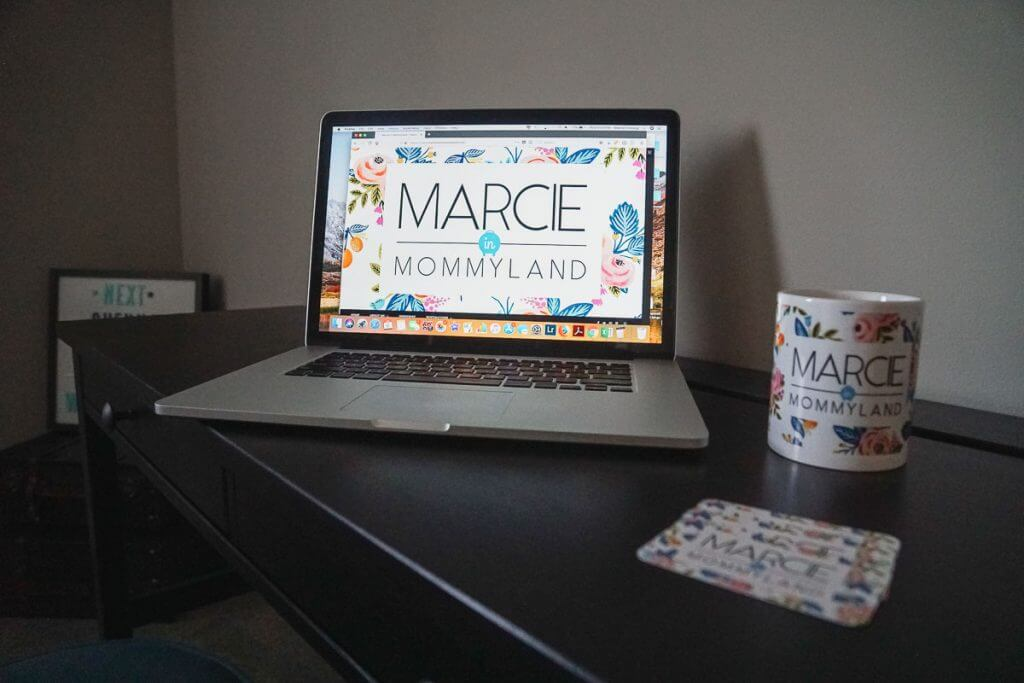 Photo of Marcie in Mommyland blog, custom mug, and business cards for bloggers #familytravelblog #travelblog #momblog #mommyblog
