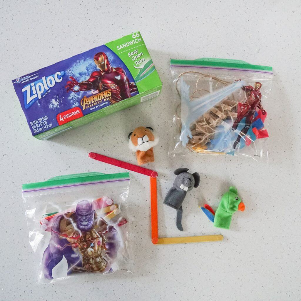 Photo of toddler and preschooler busy bags for family travel #ziploc #familytravel #busybags #activitybags #flyingwithkids