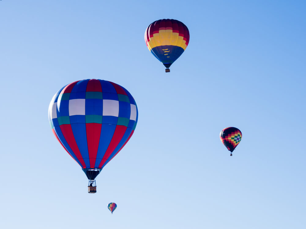 Colorful hot air balloons flying in the sky during Winthrop Balloon Festival in Washington state