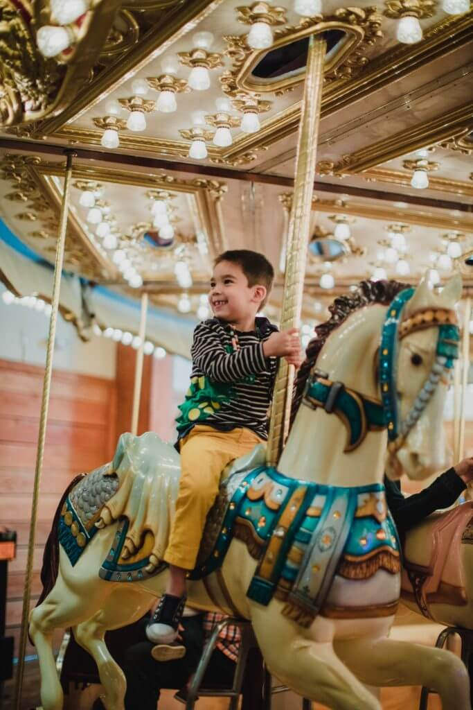 Photo of the Seattle waterfront carousel at Miner's Landing at Pier 57, which is a fun Seattle waterfront activity for kids #seattle #pier57 #seattlecarousel #carousel #seattlewithkids