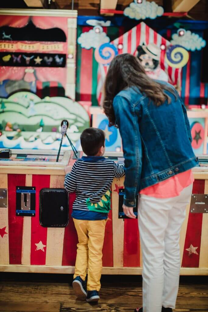 Photo of carnival games near the Seattle waterfront carousel at Pier 57 on the Seattle waterfront #seattle #seattlewithkids #carnival #seattlewaterfront #pier57 #minerslanding