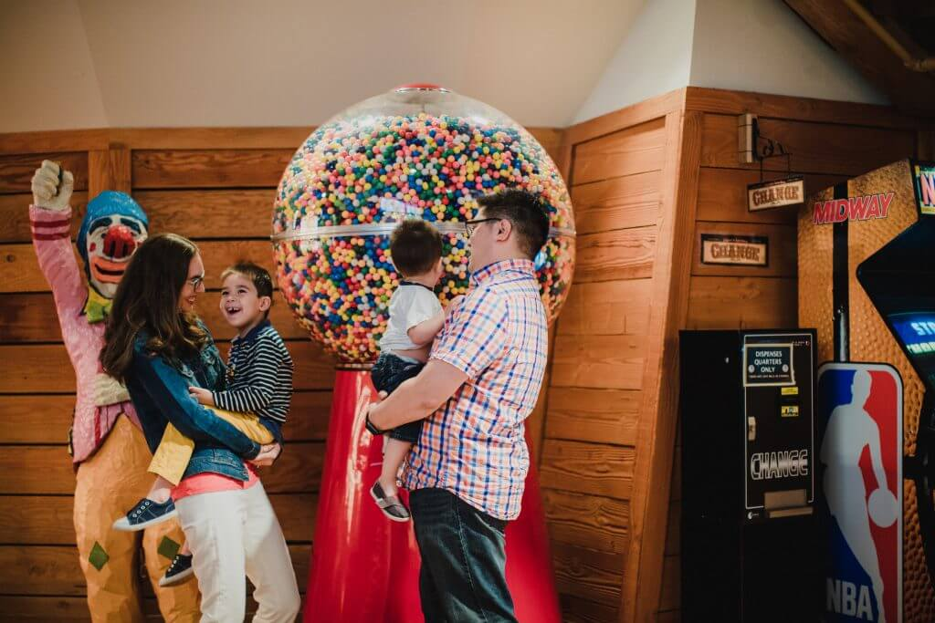 Photo of a giant gumball machine inside Miner's Landing at Pier 57 in Seattle, which is a fun thing to do with kids in Seattle #gumball #pier57 #minerslanding #seattlewithkids #visitseattle