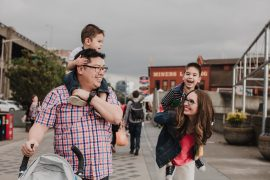 Photo of a family exploring the Seattle Waterfront at Pier 57 #pier57 #seattle #seattlewaterfront #seattlewithkids