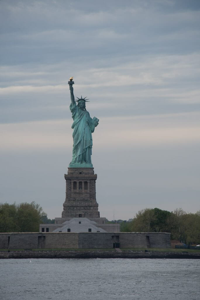 Photo of the Statue of Liberty from the Staten Island ferry, which is a free thing to do in NYC on a New York City 4 Day Itinerary #nyc #statueofliberty #freethingtodoinnyc #statenislandferry