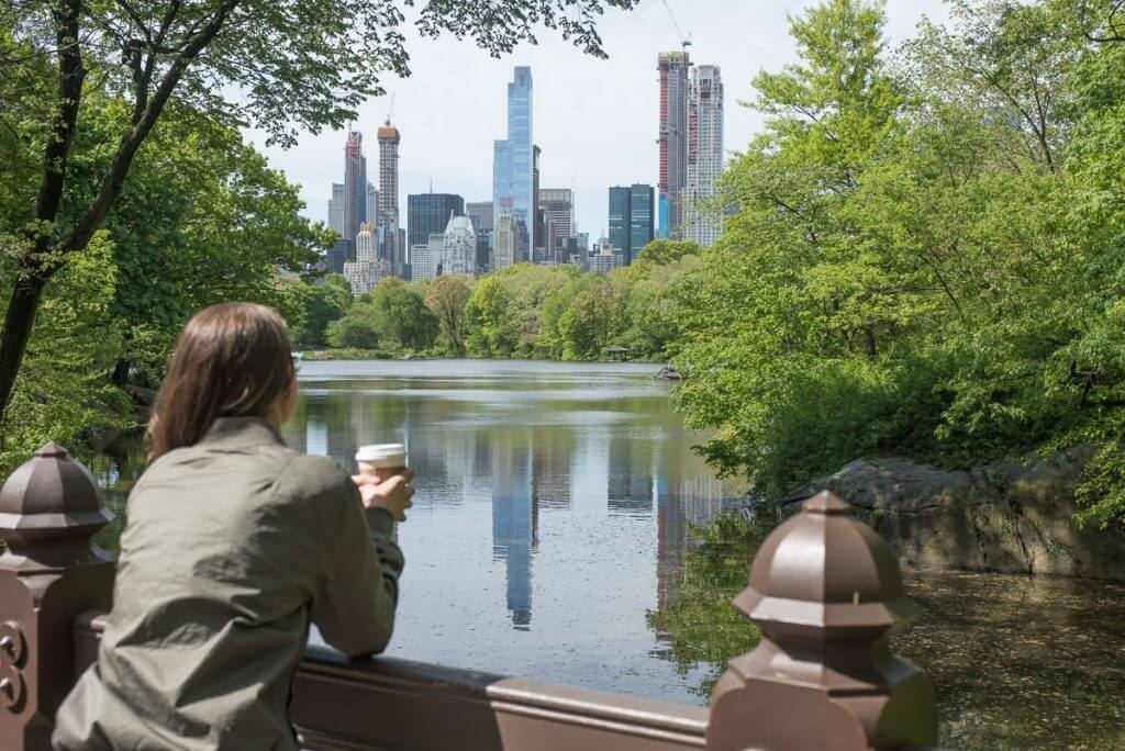 Photo of the Manhattan skyline from Central Park in New York City, which is a free thing to do in NYC #centralpark #manhattan #manhattanskyline #nycphoto #travelnyc #nycgo