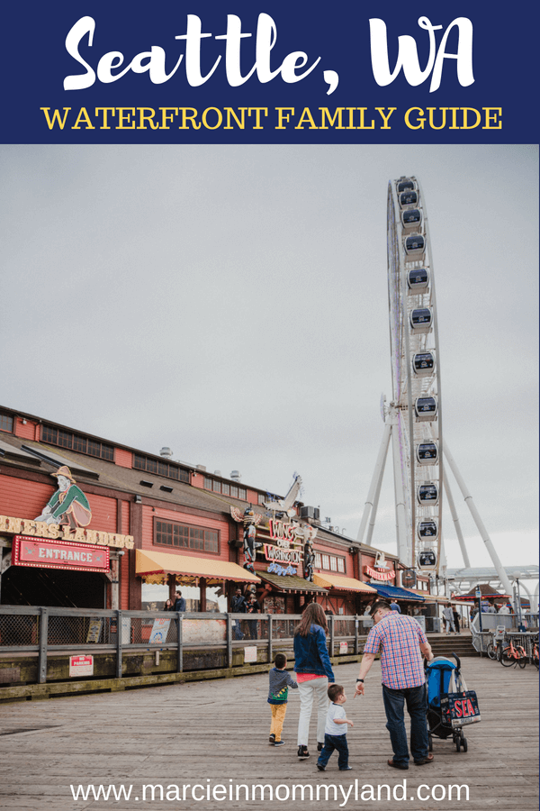 Going to Seattle with kids? Check out my Seattle Waterfront family guide featuring kid-friendly hotels, restaurants, and Seattle family attractions. Click to read more or pin to save for later. www.marcieinmommyland.com #pier57 #seattle #seattlewithkids #familytravel #visitseattle #minerslanding #seattlegreatwheel #wingsoverwashington #washingtonstate